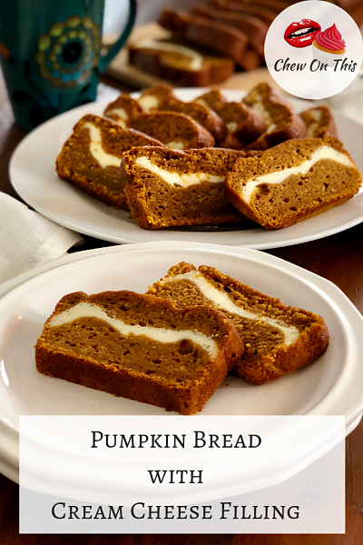 Pumpkin Bread with Cream Cheese Filling | This easy recipe with Greek yogurt bakes up a moist pumpkin bread stuffed with slightly sweetened cream cheese and spiced perfectly with homemade pumpkin pie spice!