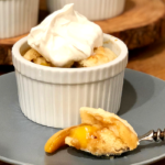 Individual Peach Cobbler | Sweet peaches baked with brown sugar and topped with a soft biscuit...yes please! Pass me that peach cobbler!