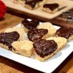 Chocolate Covered Rice Krispie Hearts | Rice Krispies treats are awesome...shape them into hearts and dip them in chocolate and they're ready for your Valentine!